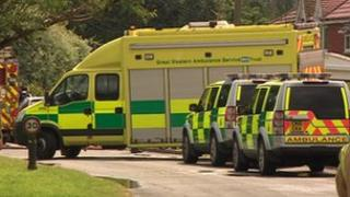 Police and ambulance crews at the scene of the explosion