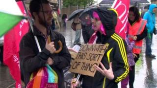 G8 protesters with sign