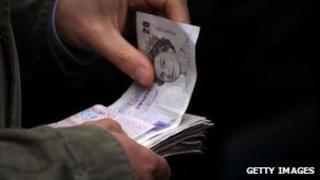 Man holding pound notes