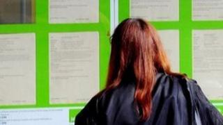 Woman looking at job advertisements