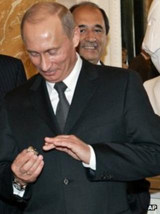 File photo of President Vladimir Putin with diamond-encrusted Super Bowl ring