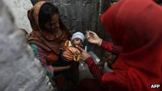 Polio workers are regularly targeted in Pakistan - file shot of child being vaccinated
