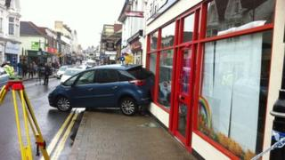 Car crashes into shop window