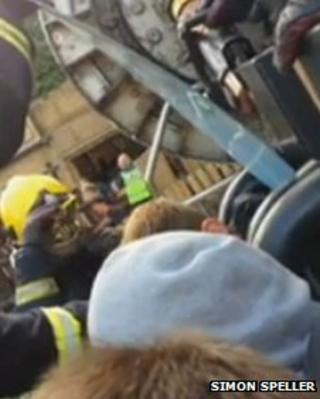 Firefighters rescuing people from ride