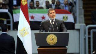 Egyptian President Mohammed Morsi addresses a rally to show solidarity with the people of Syria, 16 June 2013