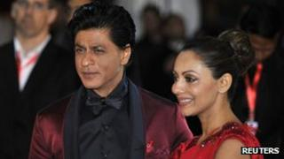 Actor Shah Rukh Khan and his wife Gauri Khan arrive for the inaugural Times of India Film Awards in Vancouver