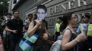 Supporters of Edward Snowden, a former CIA employee who leaked top-secret information about US surveillance programs demonstrate outside the Consulate General of the United States in Hong Kong 15 June 2013