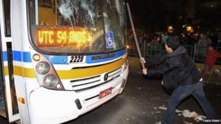 A youth smashed the windscreen on a bus in Porto Alegre on 17 June 2013