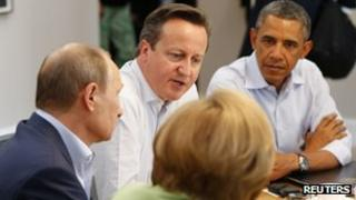 David Cameron (C) chairs a trade summit as he sits with Barack Obama (R) and Vladimir Putin (L) at the G8 summit at Lough Erne in Enniskillen, Northern Ireland (17 June 2013)