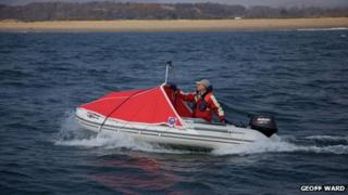 Arnold Grayston in his boat while on a trip around Wales