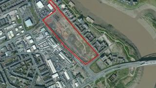 An aerial view shows the site outlined in red