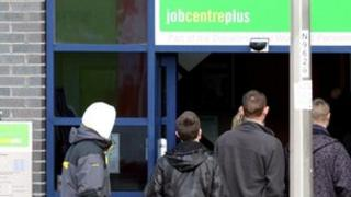 Men entering a Job Centre plus office in Gateshead