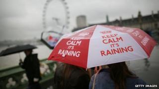 "Brolly in rain, reading: ""Keep calm it's raining"""