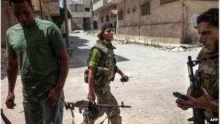 Syrian rebel fighters in the southern Syrian town of Maaret al-Numan, June 2013