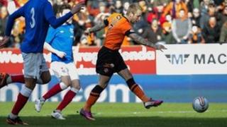 Johnny Russell scores for Dundee United against Rangers