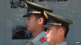 Chinese paramilitary officers patrol outside the North Korean embassy in Beijing on June 19, 2013