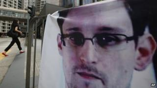 A banner supporting Edward Snowden is displayed at Central, Hong Kong's business district, 20 June 2013