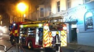 Firefighters outside Fat Cat Bar on Bridge Street