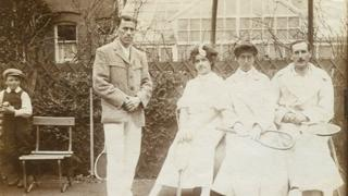 A young boy stands alongside Wimbledon champions Norman Brookes and May Sutton, and the Hillyards.