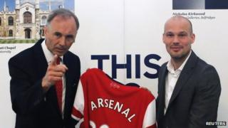 Arsenal club ambassador and former player Freddie Ljungberg (right) and British ambassador to Japan Tim Hitchens pose with a jersey as Ljungberg promotes Arsenal's Asia tour at the British Embassy in Tokyo on 7 June 2013