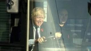 Boris Johnson behind the wheel of one of the new buses in Ballymena