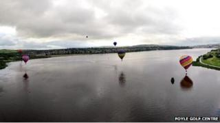 At one point, the balloons skimmed low over the River Foyle