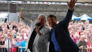 BBC Radio Ulster's Hugo Duncan and singer Dominic Kirwan at Guildhall Square for Music City