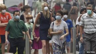 People in Singapore wear masks against the smog. 21 June 2013