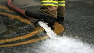 A fire fighter pumps out flood water
