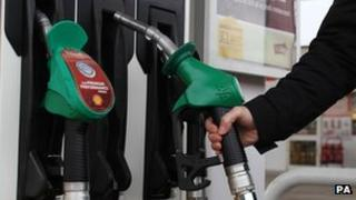A motorist filling up with petrol