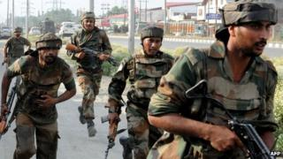 Indian soldiers at the scene of the shooting in Srinagar on 24 June 2013
