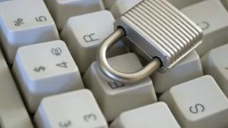 Lock sitting on computer keyboard