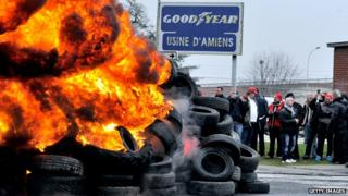 Workers burn tyres at the Goodyear factory in Amiens, France