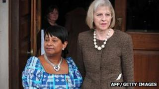 Home Secretary Theresa May (right) with Doreen Lawrence, mother of murdered teenager Stephen Lawrence, outside St Martin-in-the-Fields Church in central London on 22 April 2013 as they attend a memorial marking the 20th anniversary of his death