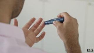 Man testing blood sugar levels