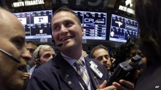 Trader Jonathan Corpina smiles as he works on the floor of the New York Stock Exchange