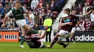 Ross Caldwell scoring for Hibs against hearts