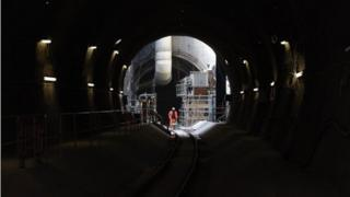 Construction worker standing in a Crossrail tunnel