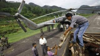Wood to be loaded on to an Indian Air force helicopter, in Gauchar, in Uttarakhand, on June 25, 2013