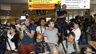 Journalists pursue Edward Snowden at Moscow's Sheremetyevo airport on 23 June