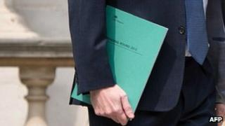 The chancellor carries the Spending Review documents