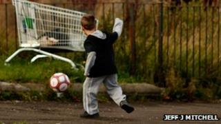 Poor child plays football