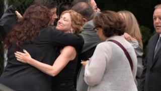 Edie Falco with mourners