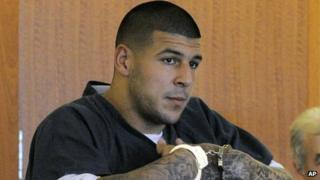 Former New England Patriots football tight end Aaron Hernandez stands during a bail hearing in Fall River Superior Court 27 June 2013