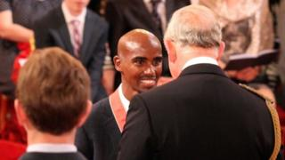 Mo Farah being awarded an CBE from the Prince of Wales