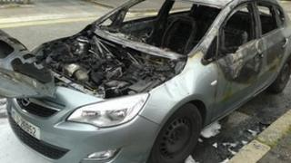 The car, which had a Dublin registration plate, was found burned out near the group's city centre hotel