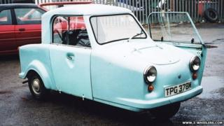 A light blue AC invacar