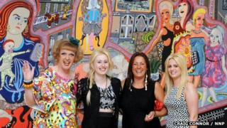 "Grayson Perry, with three of the women featured in ""Adoration of the Cage Fighters"