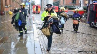 Fire and police officers with coats rescued from Almost Famous