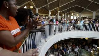 Protestors and supporters gather around the balcony overlooking the House and Senate floors during a demonstration at the state legislature in Raleigh, North Carolina 17 June 2013